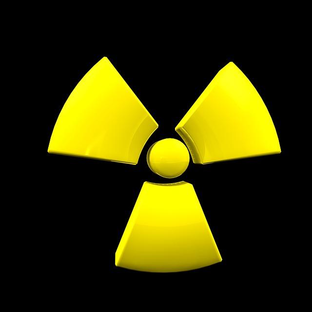 znak atomu žlutý
